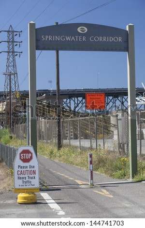 The entrance to Portland, Oregon's new Springwater Corridor is graced with an unappealing factory. - stock photo