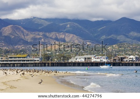 The entrance to Santa Barbara harbor with Stearn's Wharf in the background. - stock photo