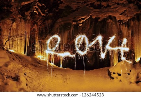 The entrance to the ice cave and PF 2014 - stock photo