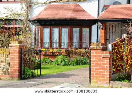 The entrance to the lovely English cottage - stock photo