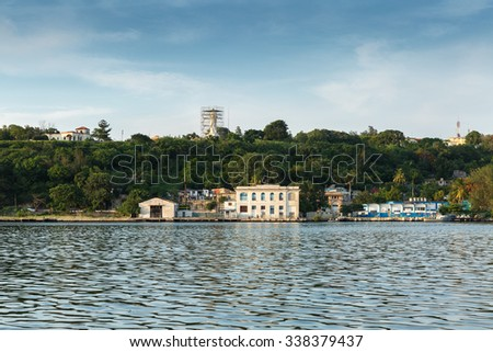 The entrance to the port of Havana, Cuba, with a statue of Jesus Christ on a hill overlooking the port and the bay of Havana. Space for copy to be overlaid on the image. - stock photo