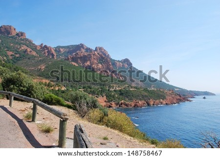 The Esterel Massif, red rocks on the Corniche d'Or road on Mediterranean sea, Var, Provence, France - stock photo
