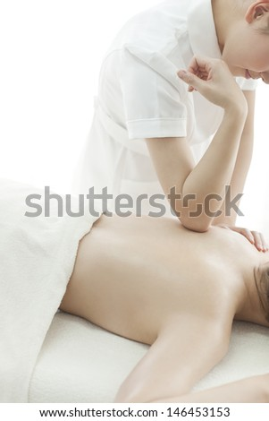 The esthetician who massages a back - stock photo