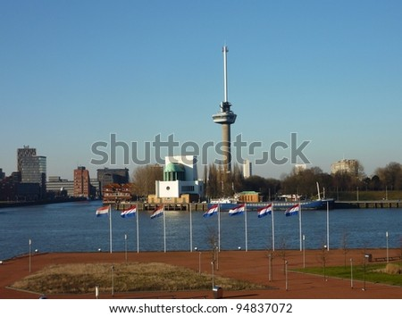 The euromast along the river Meuse in Rotterdam in the Netherlands with  Dutch national flags - stock photo