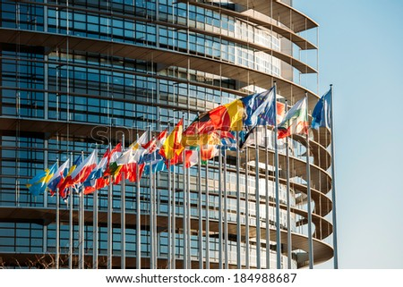The European Parliament building in Strasbourg, France with flags waving on a spring evening - stock photo