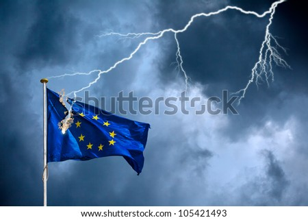 The European Union suffers from a crisis, visualized by the European flag struck by lightning during a storm - stock photo