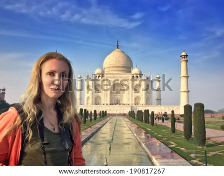 the European woman the tourist against Taj Mahal  - stock photo