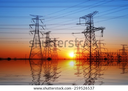 The evening electricity pylon silhouette, it is very beautiful - stock photo