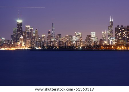 The evening view of Chicago's Skyline from Montrose Harbor - stock photo