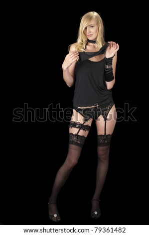 The Evening Wear Striptease Sequence #16:  Removing her glove. - stock photo