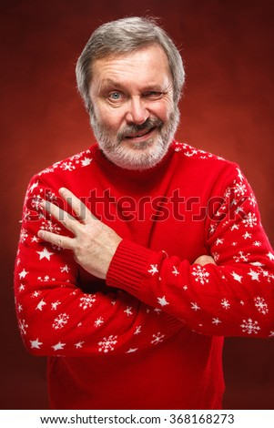 The expressive portrait on red background of a pouter man  - stock photo