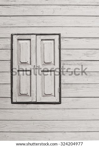 The external wood window and wall of a vintage wood house - stock photo