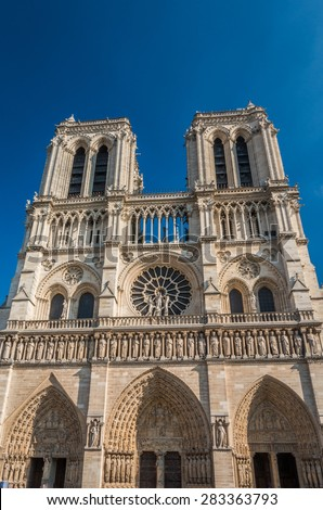 The facade of Notre Dame Cathedral in Paris - stock photo