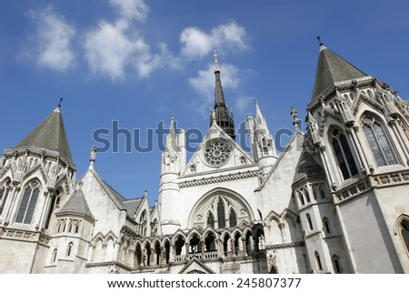 The facade of Royal Courts of Justice in London. - stock photo