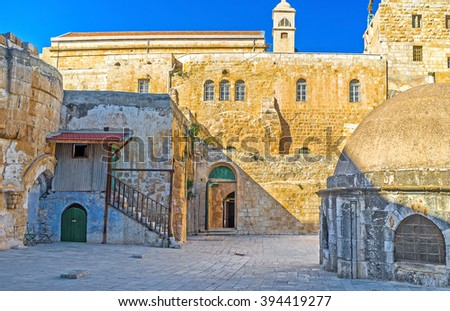 The facade wall of the Ethiopian Monastery (Deir El-Sultan), located on the rooftop of the Church of the Holy Sepulchre, Jerusalem, Israel. - stock photo