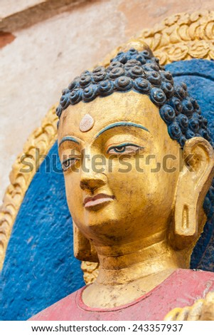 The face of a statute of Buddha in Nepal - stock photo