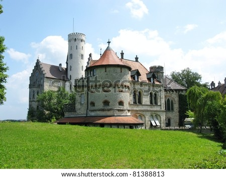 The fairy tale lichtenstein castle with its white watchtower in the Black Forest in Germany - stock photo