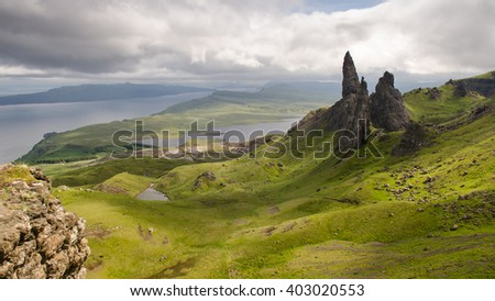 The fairytale landscape of the Trotternish peninsula on the Isle of Skye in the Highlands of Scotland, with the landslip stacks of the Old Man of Storr. - stock photo