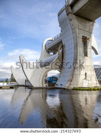 The Falkirk Wheel is a rotating boat lift in Falkirk, Scotland, connecting the Forth and Clyde Canal with the Union Canal. - stock photo