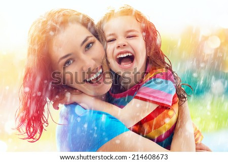the family enjoys the rain - stock photo