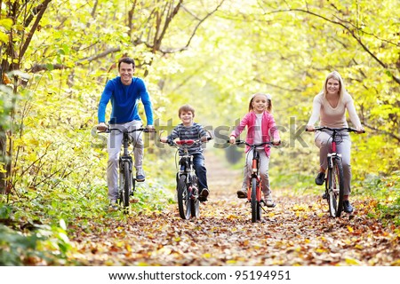 The family in the park on bicycles - stock photo