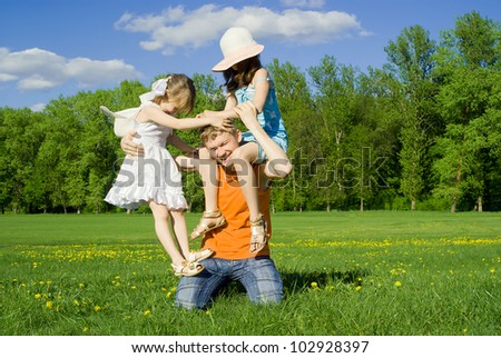 the family plays on nature - stock photo