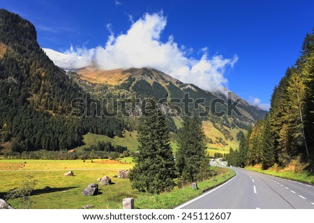 The famous Alpine road Grossglocknershtrasse. The autumn in the Austrian Alps. The beautiful sunny day in the national park of the Grossglockner.  - stock photo