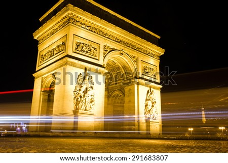 The famous Arc de Triumph at night, Paris, France - stock photo
