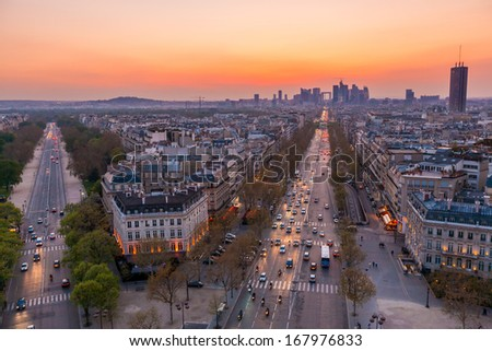 The famous champs elysees in Paris from the top of the Arc De Triomphe at night.  - stock photo
