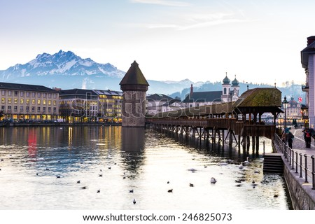 The famous Chapel Bridge in Lucerne, Switzerland. - stock photo
