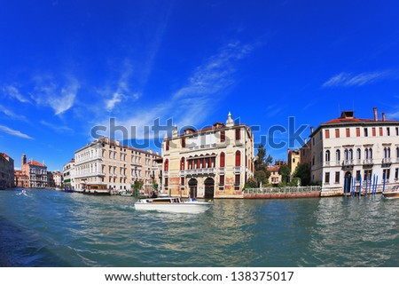 The famous Grand Canal in Venice. In the foreground is a graceful white yacht. Photo taken by lens Fisheye - stock photo