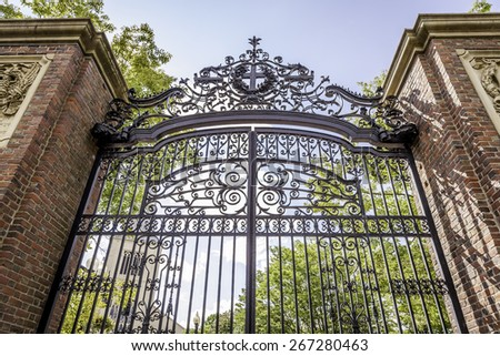 The famous Harvard University in Cambridge, Massachusetts, USA showcasing a shot of one of its historic iron gates. - stock photo