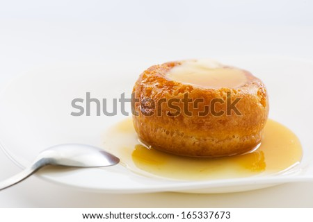 The famous Italian sweet Baba of Naples with rum syrup - stock photo