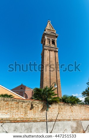 The famous leaning campanile of San Martino on the island of Burano, Venice, Italy, a popular tourist attraction - stock photo