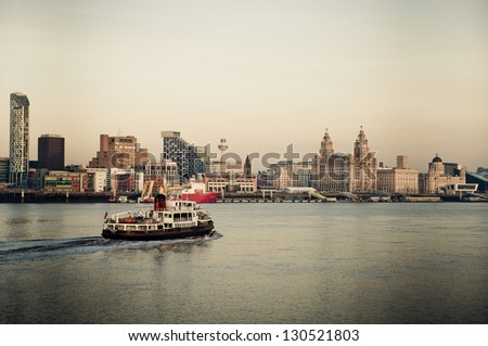 The famous Mersey Ferry sailing back across the Mersey towards Liverpool - stock photo