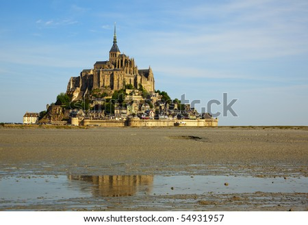 the famous Mont-St-Michel in France at ebb tide - stock photo