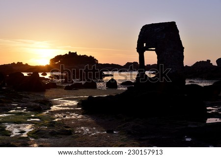 The famous old Oratoire Saint-Guirec building and Saint-Jacques church at low tide on the Pink Granite Coast (cote de granite rose in french) of Ploumanac'h, village in the commune of Perros-Guirec - stock photo