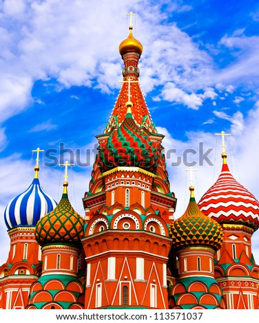 The Famous St Basils cathedral on Red Square in Moscow, beautiful colorful cupolas over blue cloudy sky - stock photo