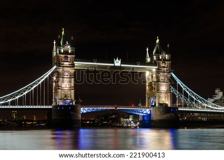 The famous Tower Bridge  in London illuminated at night - stock photo