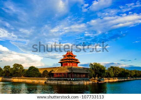the famous watch tower of forbidden city in sunset - stock photo