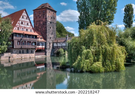 The famous Weinstadel and Wasserturm (Water Tower) over the river Pegnitz in the German city of Nuremberg. - stock photo