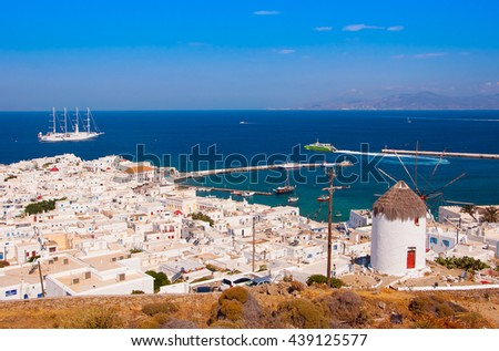 The famous windmill above the town of Mykonos in Greece against the blue sky - stock photo