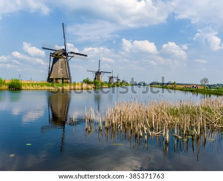 The famous windmills of Kinderdijk, Holland on a beautiful spring day. - stock photo