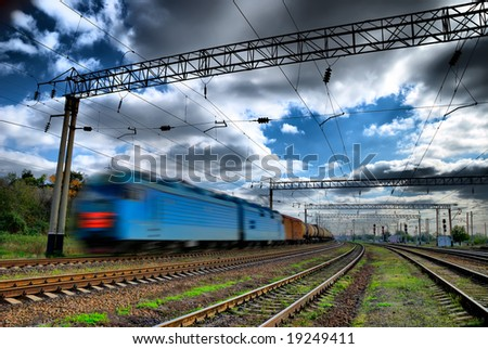 The fast train rushes in the dark sky - stock photo