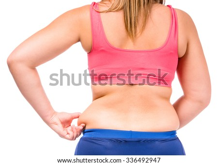 The fat woman unhappy with her body isolated on white background - stock photo