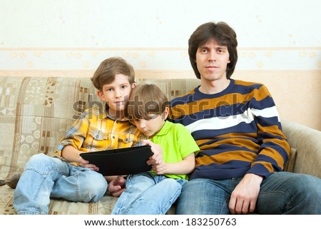 The father and two boys with tablet PC - stock photo