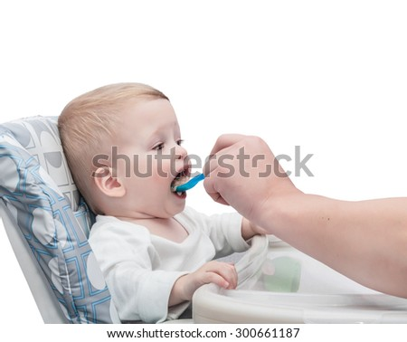 The father feeds with porridge of the one-year-old kid,  isolated on the white  - stock photo
