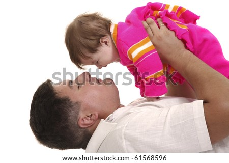 The father plays with the small daughter - stock photo