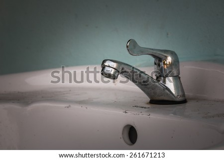 the faucet in bathroom - stock photo