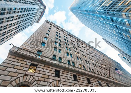 The Federal Reserve Bank of New York, upward view, and surrounding buildings. - stock photo